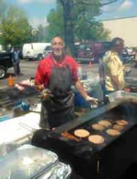 nick-serves-hamburgers-at-chicago-jondon-customer-appreciation-day