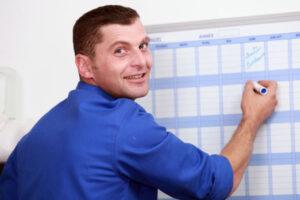 man filling work calendar