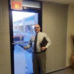 jerry grant usint his necktie for sales calls